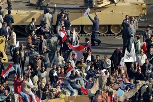 The mood on the streets of Cairo changed when pro-Government protesters arrived in Tahrir Square. Photo / AP