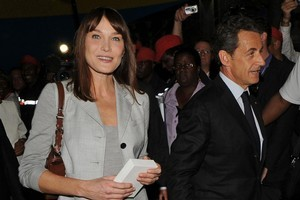 France's President Nicolas Sarkozy, right, and first lady Carla Bruni. Photo / AP