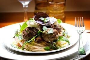 Veal meatballs, passata and ricotta. Photo / Babiche Martens