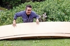 Justin Newcombe creates the template for the hull. Photo / Sarah Ivey
