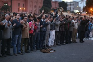 People pray in front of army tanks in Tahrir Square in Cairo, Egypt. Photo / Getty Images