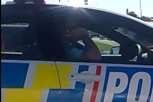 A reader's video of a policeman talking in Lincoln Road on Thursday. Photo / Supplied