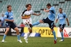Dylan Macallister of the Phoenix competes for the ball against Sebastian Ryall of Sydney FC. Photo / Getty Images