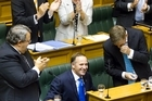 Prime Minister John Key is congratulated by colleagues after his speech in Parliament, Wellington. Photo / Mark Mitchell