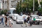 Pedestrians and traffic on Queen St in downtown Auckland. Photo / Richard Robinson