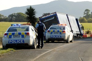 Police at the scene of the crash. Photo / Otago Daily Times