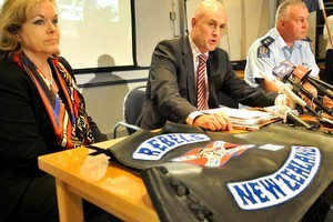 Police Minister Judith Collins, Detective Inspector Chris Bensemann (left) and Central Police District Commander Russell Gibson at a media conference following yesterday's raids. Photo / Wanganui Chronicle