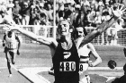 Dick Tayler crossing the finishing line to win the 10,000m race at the 1974 Christchurch Commonwealth Games. Photo / Supplied
