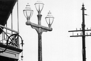 The lamps sat on top of a pole in a Ponsonby intersection after they were installed in 1873, giving the area the name 'Three Lamps.' Photo / NZ Herald Archives
