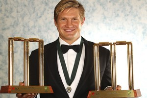 Shane Watson poses with the One-day International player of the year and Test player of the year and the 2011 Allan Border medal. Photo / Getty Images