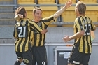 Chris Greenacre (C) of the Phoenix celebrates his goal with team mates Dylan Macallister and Marco Rojas. Photo / Getty Images