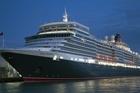 The luxury 90,900-tonne Queen Elizabeth liner arrives on her maiden visit before daybreak, Auckland. Photo / NZPA/David Rowland