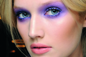 Purple hues matched with simple, glossy lips sets an edgy yet feminine look. Photo / Supplied