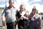 Kristy King leaving the Morrinsville District Court with her parents, Mark and Belinda today. Photo / Sarah Ivey