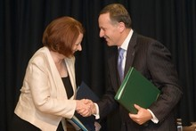 Prime Minister Johm Key and Australian Prime Minister Julia Gillard after signing the agreement at Parliament in Wellington. Photo / Mark Mitchell 