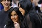 Kim Kardashian, right, talks with Nicole