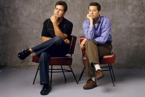 Charlie Sheen (left, with co-star Jon Cryer from Two and a Half Men) is paid a truckload of money for playing a paler version of himself. Photo / Supplied