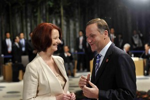 Australian Prime Minister Julia Gillard chats with New Zealand Prime Minister John Key at the APEC summit last year. Photo / Supplied