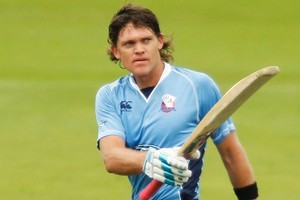 Lou Vincent  celebrates after scoring a century yesterday. Photo / Getty Images