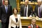 Australia's Prime Minister Julia Gillard arrives in the debating chamber. Photo / Mark Mitchell
