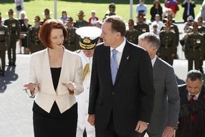 Julia Gillard and John Key enter Parliament. Photo / Mark Mitchell