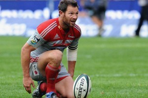 Leon MacDonald in action for the Crusaders in 2009. Photo / Getty Images