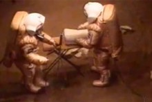 Two crew members suit up for the Mars 'landing'.