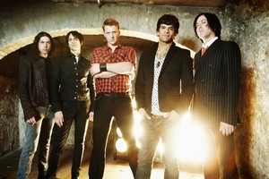 Josh Homme (above centre) formed Queens of the Stone Age after the demise of Kyuss in 1995. Photo / Supplied
