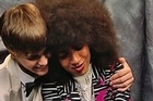 After jazz artist Esperanza Spalding caused an upset at the Grammys, beating Justin Bieber to win best new artist, the two stars shared kind words and a hug backstage.