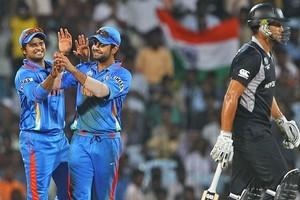 Suresh Raina of India congratulates Virat Kohli on catching Ross Taylor, off the bowling of Harbhajan Singh. Photo / Getty Images