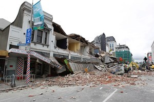 Collapsed buildings and debris along Manchester Street in Christchurch. Photo / Getty Images
