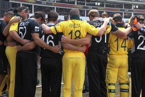 The New Zealand and Australian teams come together ahead of the second innings in a show of support for the memory of the victims of the Christchurch Earthquake. Photo / Getty Images