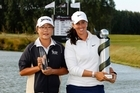 Lydia Ko of New Zealand and Kristie Smith of Australia pose with their trophies after day four of the Women's New Zealand Open at Pegasus Golf Club. Photo / Getty Images