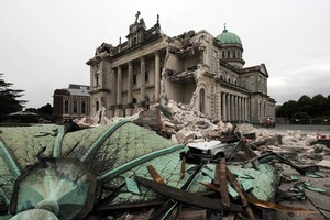 Weakened but relatively unscathed after last year's quake, the city's cathedral has suffered badly this time, losing its landmark spire and sustaining huge structural damage. Photo / NZPA