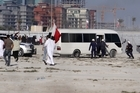 Riot police pull out as Bahraini protesters rush to celebrate at the Pearl roundabout in Manama, Bahrain. Photo / AP