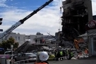 Rescue efforts have moved to recovery mode at the devastated CTV building in Christchurch, where it is believed between 60 and 120 bodies may still be trapped.