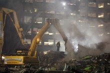Emergency services search the rumble for survivors of the collapsed CTV building. Photo / Brett Phibbs
