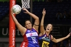 Catherine Latu (left) of the Mystics comes away with the ball as the Magic's Jodi Tod defends. Photo / Getty Images