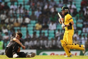 A grounded Hamish Bennett looks on as the Black Caps struggle against Australia. Photo / Getty Images