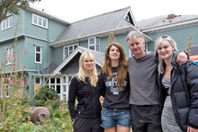 The Smith family with their Hambledon mansion in the background before the demolition. Photo / Mark Mitchell