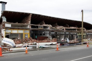 A group of damaged shops in the suburb of St. Albans. Photo / Simon Baker