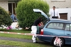 Police were at the Graham Place home of the victim yesterday finishing their scene examination. Photo / APN