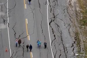 Cracks in Bridge Road, South Brighton, in Christchurch. Photo / Brett Phibbs