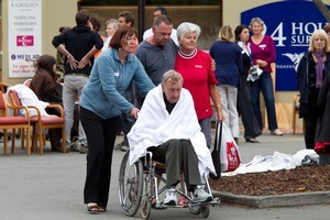 Injured residents are tended in the carpark of a 24-hour surgery in Bealy Ave. Photo / Simon Baker