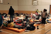 People settle down for a night's sleep in the Burnside High School gymnasium. Photo / Sarah Ivey