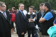 John Key talks with people gathered at the Civil Defence Emergency Centre at Hagley Park. Photo / Greg Bowker