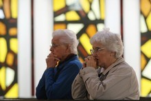Parishioners pray as Christchurch Bishop Barry Jones celebrates Mass at Our Lady of Victories Catholic Church yesterday. Photo / Greg Bowker
