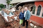 Neil Struthers and wife Robyn outside Lyttelton's Holy Trinity Church with their son's crushed car. Photo / Sarah Ivey