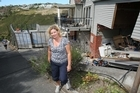 Jane Potts outside the damaged family home in Santa Maria Ave. Photo / Greg Bowker