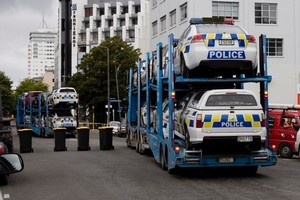 Trucks bring in back-up police cars to Christchurch after the earthquake. Photo / Dean Purcell